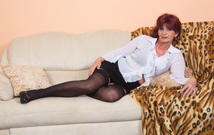 Clothed grandmother strips to her nylons as she readies to masturbate