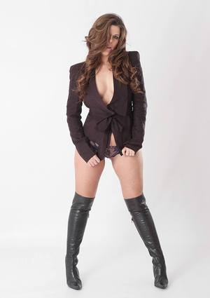 Huge boobed brunette Leanne posing in her sexy black leather boots