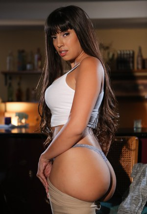 Latina female with great legs Mercedes Carrera does a striptease in kitchen