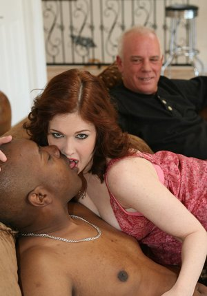 Hot redhead wife enjoys a big black cock cowgirl style in front of hubby