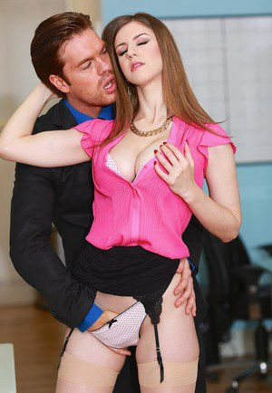 Office slut Stella Cox bangs a coworker at her desk in tan stockings and heels