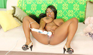 Black female Marie Leone uncovers gigantic boobs before masturbating with toys
