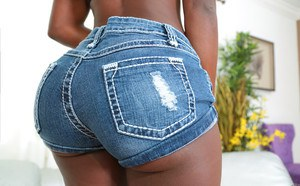 Ebony girl sheds shorts & hot panties to reveal big booty & get covered in cum