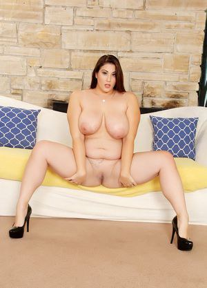 Mature BBW Angel Deluca in skirt spreading legs and showing huge boobs