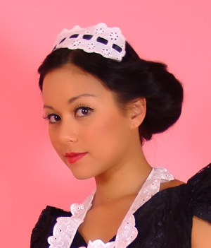 Pinup model Petra Lily So doffs her maid outfit to go topless