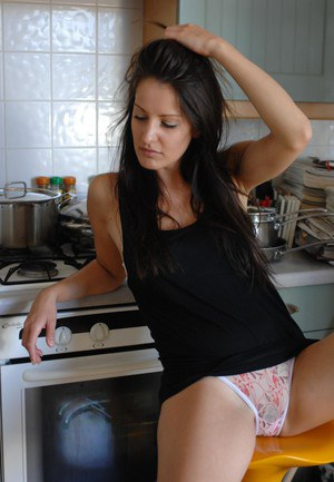 Solo girl gets up on her stovetop to show off her upskirt underwear