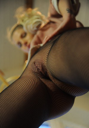 Natural blonde chick Danielle Maye rips open her mesh pantyhose