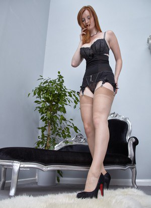 Natural redhead Zara Du Rose strips down to a girdle and nylons