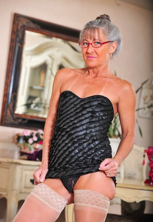Granny with cute glasses Leilani Lei strips down naked at her place