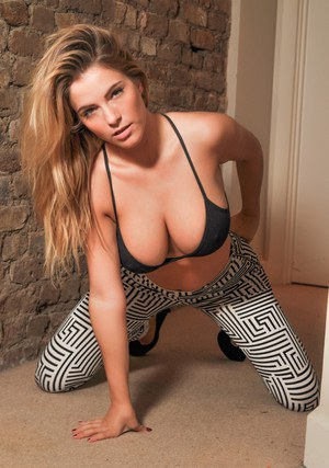 Blond girl Jess Kingham takes off her bra before sliding leggings over her ass
