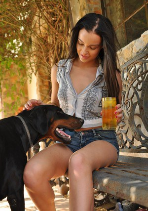 Solo girl Kayleigh Williams enjoys a cool drink while walking nude on sidewalk