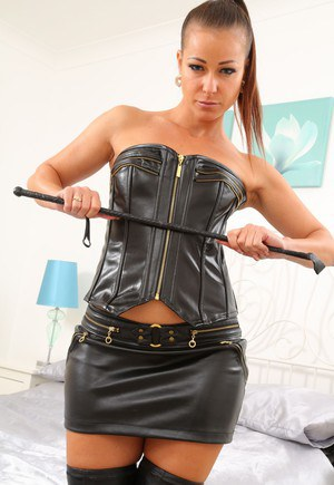 Hot mistress Kristina removes leather lingerie to pose in boots with her whip