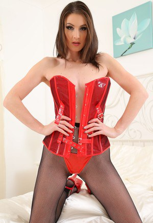 Busty redhead domina Avery posing in pantyhose and sexy red corset