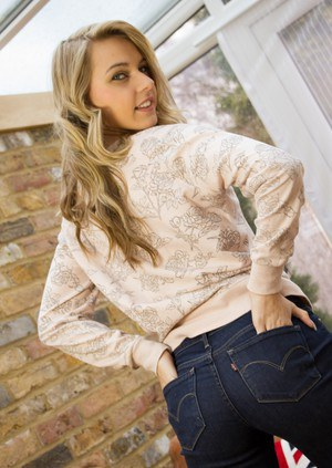 Solo model Chloe Toy slides her jeans over her sexy ass as she strips