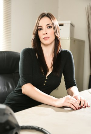 Brunette MILF Jelena Jensen in boots and jeans stripping at the office