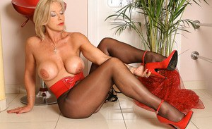 Long legged hot mature Astrid gets topless to rub her clit in sheer pantyhose
