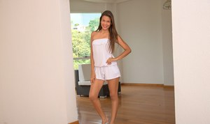 Teen girl next door Kiara Lorens shows off her bare legs while clothed