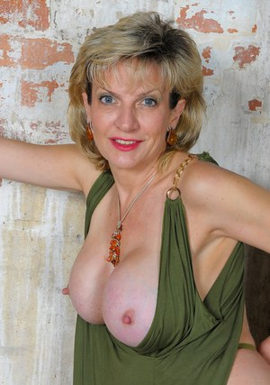 Mature blonde female Lady Sonia releases her big boobs from her short dress