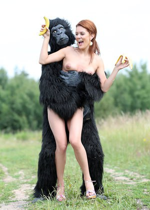 Sexy redhead cosplay chick Becca romps nude outdoors in heels with gorilla