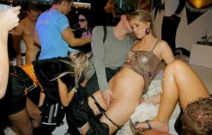 Clothed European party girls give male strippers oral sex before wild orgy sex