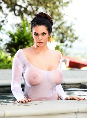 Busty Alison Tyler poses in her incredibly sexy bikini by the pool