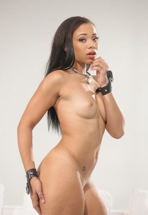 Hot black chick Adrian Maya strips of a red dress to pose in the nude