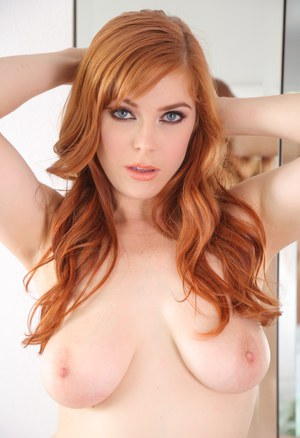 Redhead Penny Pax in jeans undressing to show her hot tits in the bathroom