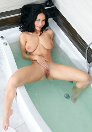 Teen babe Mila M shedding swimsuit in shower to flaunt nice ass