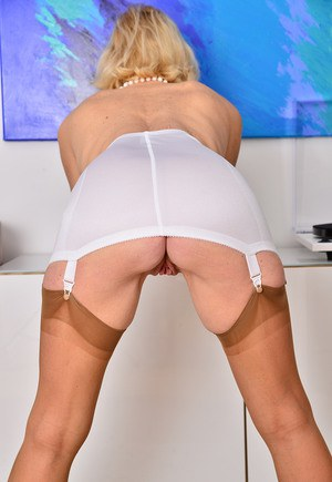 Mature lady Molly Maracas flashes nude pussy topless in girdle and stockings