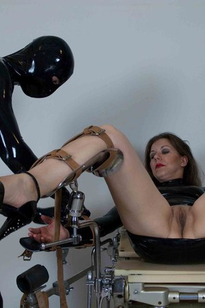 Bottomless female sex slave is machine fucked while strapped to gyno chair