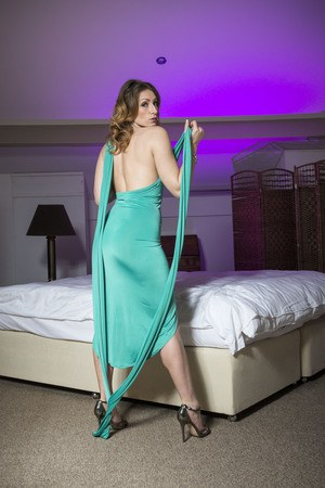 Elegant housewife Ava Austin doffs gown to reveal small tits & sexy long legs