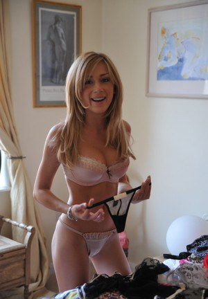 Cute blonde girl trades in one set of lingerie for another