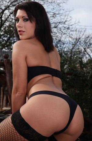 Dark haired chick Scarlet Jons strips to black stockings before anal