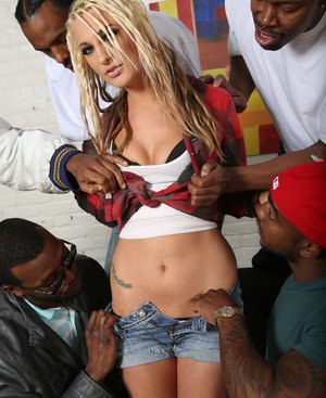 Blond slut Hailey Holiday puts out her smoke prior to an interracial gangbang