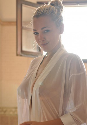 Beautiful blonde chick Jodie Gasson pulls on a see thru blouse in the morning