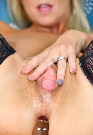 Raunchy blonde cougar with massive melons slides a dildo in her anus
