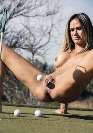 Busty MILF flashes cunt in public before squirting golf balls from cunt