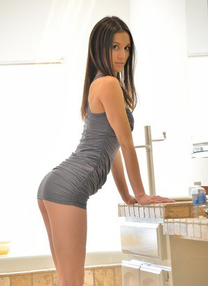 Thin brunette girl peeling off tight dress to tout tight butt and bald twat