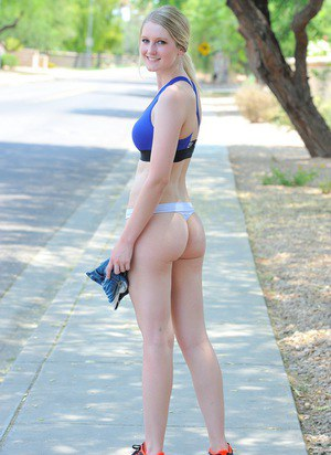 Blondes sports babe in shorts & pigtails strips to show bare ass outdoors