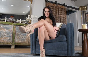 Long legged brunette Megan Rain in heels toying her spread pussy