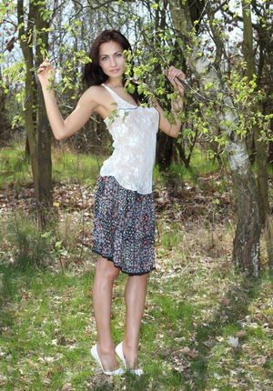 Long legged Michaela Isizzu flashes naked upskirt and poses nude in the forest