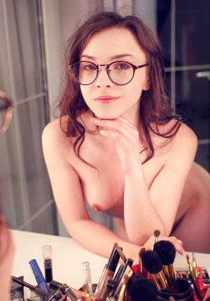 Glasses topped brunette babe Una Piccola revealing hairy cunt in bathroom
