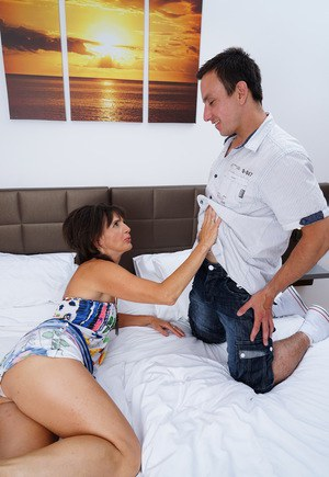 Cheating housewife frolics with her daytime lover on her marital bed