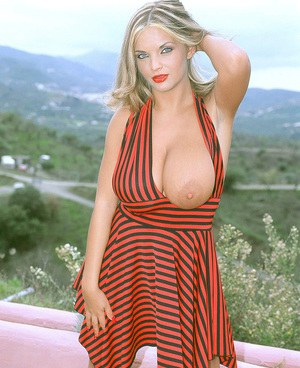 Massive titted Ines Cudna likes to feel the cool breeze on her hot knockers