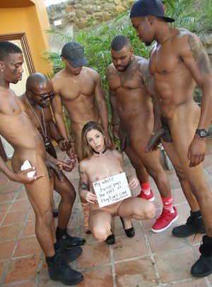 Blond slut Ryan Riesling lets a group of black men shoot their seed inside her