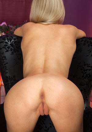 Blonde glamour babe displaying legs in long socks before baring shaved cunt