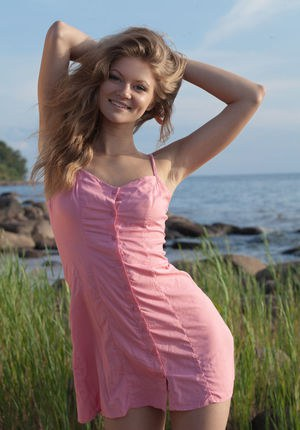 Beach babe Patritcy A revealing tiny teen breasts outdoors for glamour pics