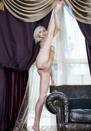 Flexible blonde girl Lija showing off great legs and pussy in the nude