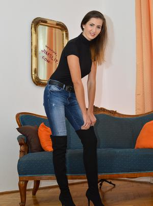 Brunette slut in jeans and boots spreading legs to flaunt her hot bare ass