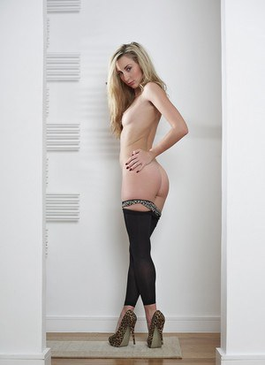 Blonde model Sophia Smith pulls down her pantyhose to show it all off